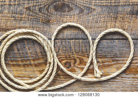 rope gyrate on a wooden table close up