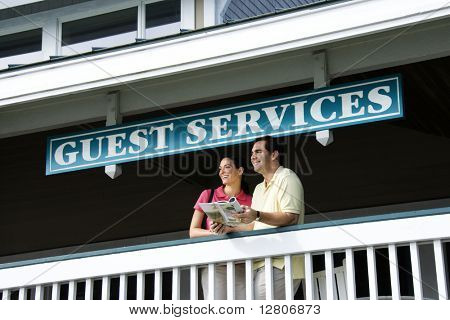 Mid-adult Caucasian couple looking out at guest services at Bald Head Island, North Carolina.