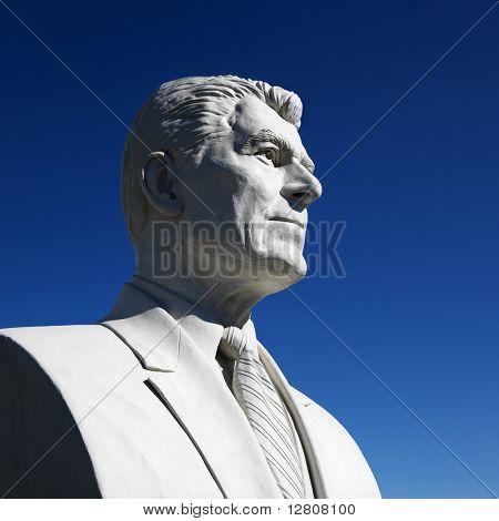 Bust of Ronald Reagan sculpture against blue sky in President's Park, Black Hills, South Dakota.