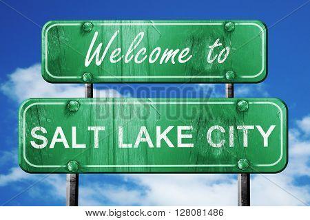 salt lake city vintage green road sign with blue sky background