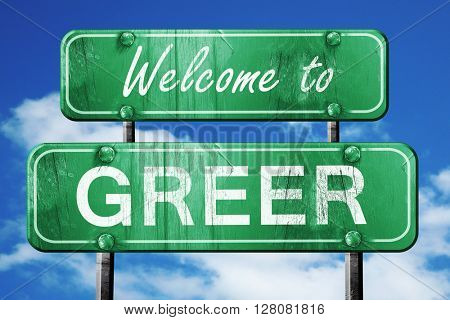greer vintage green road sign with blue sky background