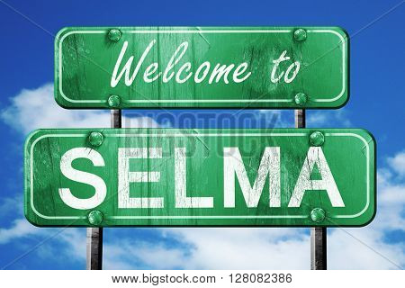 selma vintage green road sign with blue sky background