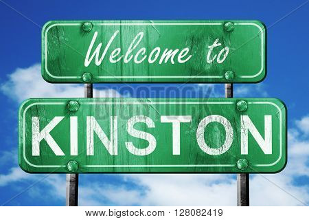 kinston vintage green road sign with blue sky background