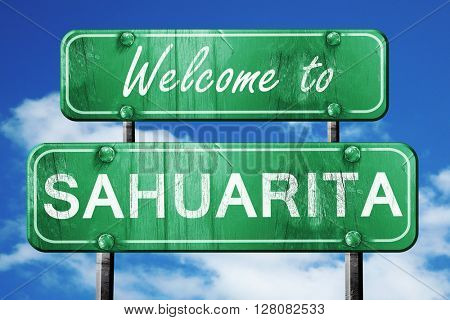 sahuarita vintage green road sign with blue sky background