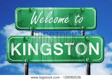 kingston vintage green road sign with blue sky background