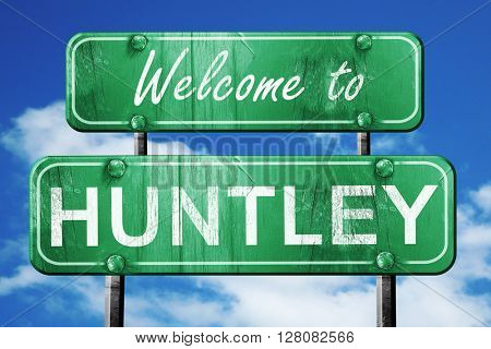 huntley vintage green road sign with blue sky background