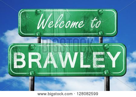 brawley vintage green road sign with blue sky background