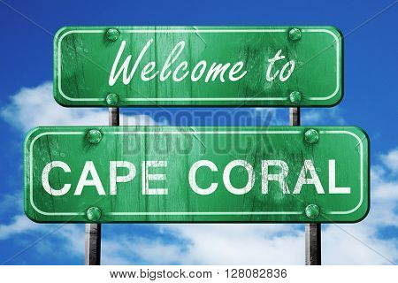 cape coral vintage green road sign with blue sky background