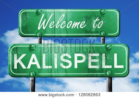 kalispell vintage green road sign with blue sky background