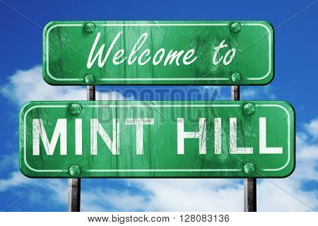 mint hill vintage green road sign with blue sky background