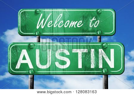 austin vintage green road sign with blue sky background