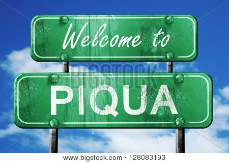 piqua vintage green road sign with blue sky background