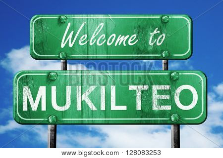 mukilteo vintage green road sign with blue sky background