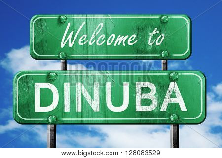 dinuba vintage green road sign with blue sky background