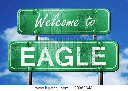eagle vintage green road sign with blue sky background