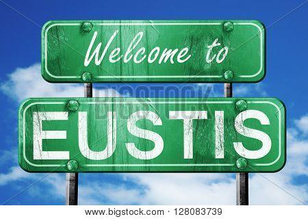 eustis vintage green road sign with blue sky background