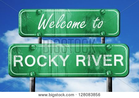 rocky river vintage green road sign with blue sky background