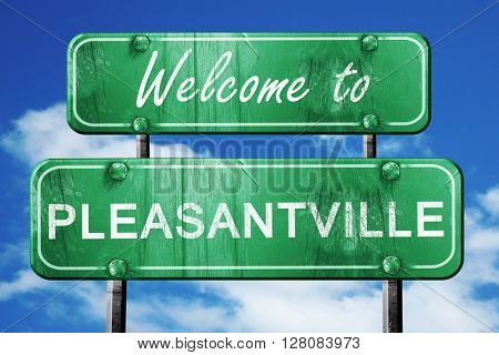 pleasantville vintage green road sign with blue sky background