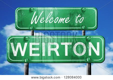 weirton vintage green road sign with blue sky background