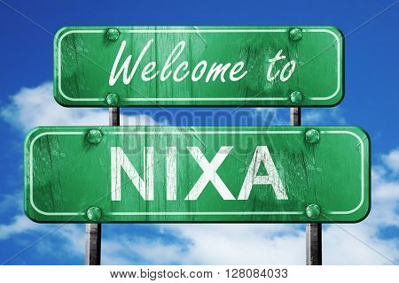 nixa vintage green road sign with blue sky background