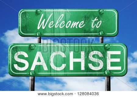 sachse vintage green road sign with blue sky background