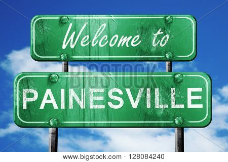 painesville vintage green road sign with blue sky background
