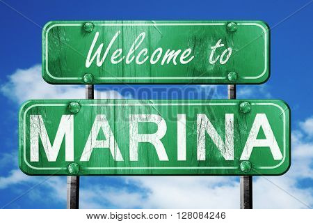 marina vintage green road sign with blue sky background