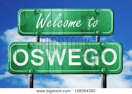 oswego vintage green road sign with blue sky background