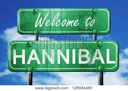 hannibal vintage green road sign with blue sky background