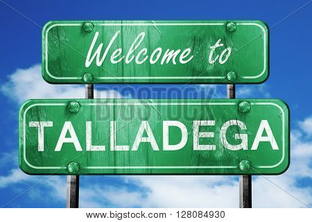 talladega vintage green road sign with blue sky background