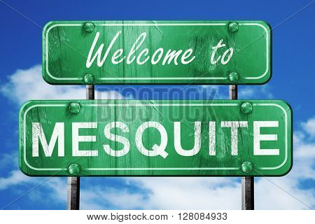 mesquite vintage green road sign with blue sky background