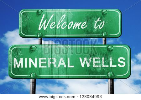 mineral wells vintage green road sign with blue sky background