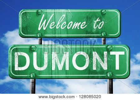 dumont vintage green road sign with blue sky background