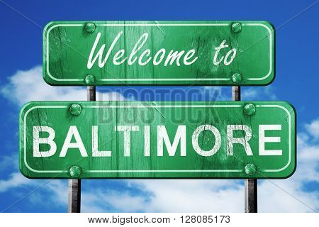 baltimore vintage green road sign with blue sky background