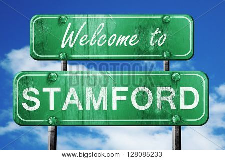 stamford vintage green road sign with blue sky background