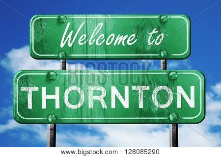 thornton vintage green road sign with blue sky background