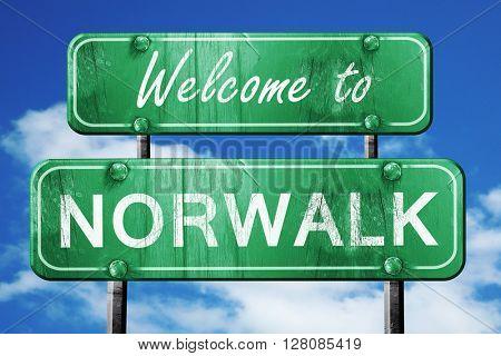 norwalk vintage green road sign with blue sky background