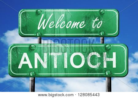 antioch vintage green road sign with blue sky background