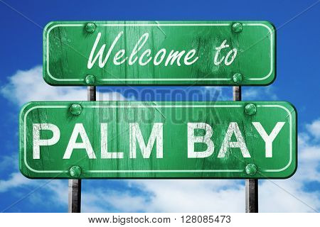 palm bay vintage green road sign with blue sky background
