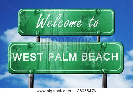 west palm beach vintage green road sign with blue sky background
