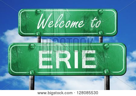 erie vintage green road sign with blue sky background