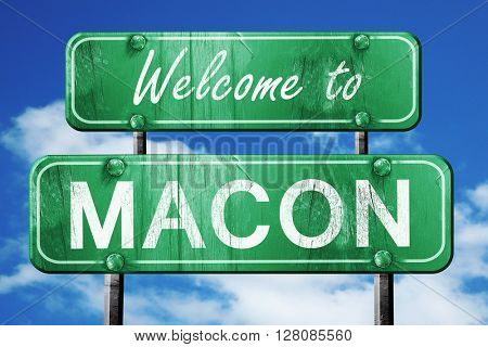 macon vintage green road sign with blue sky background
