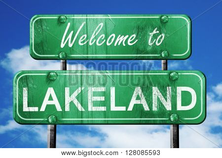 lakeland vintage green road sign with blue sky background