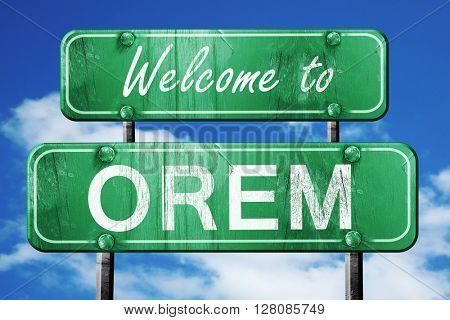 orem vintage green road sign with blue sky background