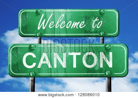 canton vintage green road sign with blue sky background