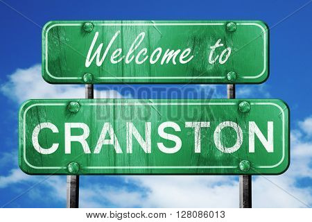 cranston vintage green road sign with blue sky background