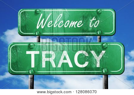 tracy vintage green road sign with blue sky background