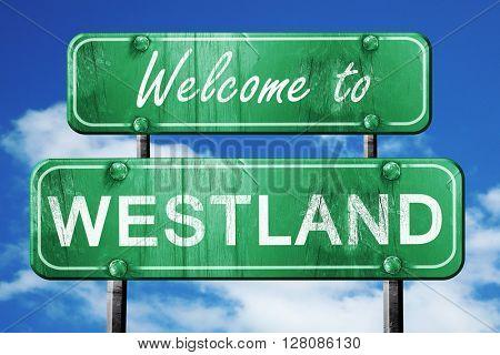 westland vintage green road sign with blue sky background