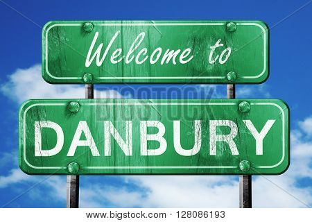 danbury vintage green road sign with blue sky background