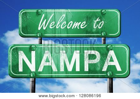 nampa vintage green road sign with blue sky background